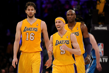LOS ANGELES, CA - APRIL 20:  Steve Blake #5 of the Los Angeles Lakers reacts between teammates Pau Gasol #16 and Lamar Odom #7 while taking on the New Orleans Hornets in Game Two of the Western Conference Quarterfinals in the 2011 NBA Playoffs on April 20