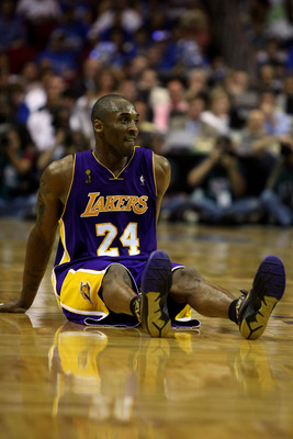 ORLANDO, FL - JUNE 14:  Kobe Bryant #24 of the Los Angeles Lakers slides acrosss the floor in the fourth quarter against the Orlando Magic in Game Five of the 2009 NBA Finals on June 14, 2009 at Amway Arena in Orlando, Florida.  NOTE TO USER:  User expres