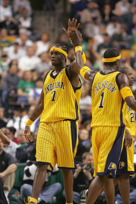 BOSTON - MAY 7:  Jermaine O'Neal #7 and Stephen Jackson #1 of the Indiana Pacers high five during the game against the Boston Celtics in Game seven of the Eastern Conference Quarterfinals during the 2005 NBA Playoffs at the FleetCenter on May 7, 2005 in B