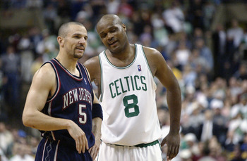 BOSTON - MAY 12:  Jason Kidd #5 of the New Jersey Nets talks to Antoine Walker #8 of the Boston Celtics in Game four of Eastern Conference Semifinals during 2003 NBA Playoffs at the Fleet Center on May 12, 2003 in Boston, Massachusetts.  The Nets won in d