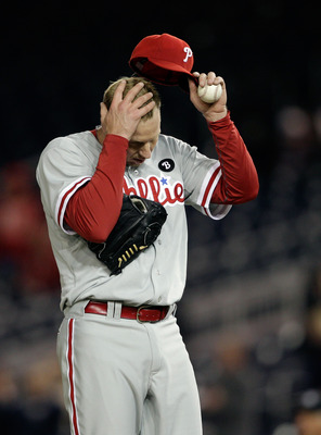 WASHINGTON, DC - APRIL 13:  Roy Halladay #34 of the Philadelphia Phillies adjust his cap after giving up a run to the Washington Nationals during the ninth inning at Nationals Park on April 13, 2011 in Washington, DC.  (Photo by Rob Carr/Getty Images)