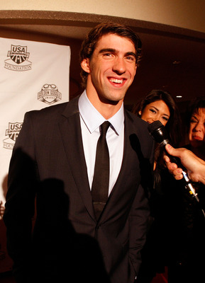 NEW YORK - NOVEMBER 22:  Michael Phelps of the U.S. National Swim Team speaks to the media on the red carpet prior to the 7th Annual Golden Goggle Awards at the Marriott Marquis on November 22, 2010 in New York City.  (Photo by Mike Stobe/Getty Images)