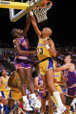 INGLEWOOD, CA - 1988:  Mark West #41 of the Phoenix Suns goes up against Kareem Abdul-Jabbar #33 of the Los Angeles Lakers during the game at the Great Western Forum in Inglewood, California. (Photo by Mike Powell/Getty Images)