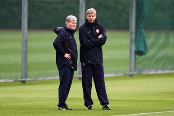 ST ALBANS, ENGLAND - OCTOBER 18:  Arsenal Manager, Arsene Wenger (R) and Assistant manager Pat Rice speak during a training session ahead of the UEFA Champions League game against Shakhtar Donetsk at the club's complex at London Colney on October 18, 2010