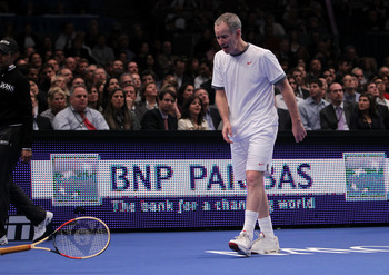 NEW YORK, NY - FEBRUARY 28:  John McEnroe throws his racquet as he reacts against Ivan Lendl during the BNP Paribas Showdown at Madison Square Garden on February 28, 2011 in New York City.  (Photo by Nick Laham/Getty Images)