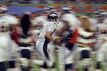 31 Jan 1999: Quarterback John Elway #7 of the Denver Broncos runs onto the field through the blur of his teammates during pre-game introductions for Super Bowl XXXIII between the Atlanta Falcons and the Denver Broncos at Pro Player Stadium in Miami, Flori