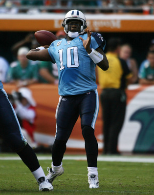 MIAMI - NOVEMBER 14:  Quarterback Vince Young #10 of the Tennessee Titans throws against the Miami Dolphins at Sun Life Stadium on November 14, 2010 in Miami, Florida.  (Photo by Marc Serota/Getty Images)