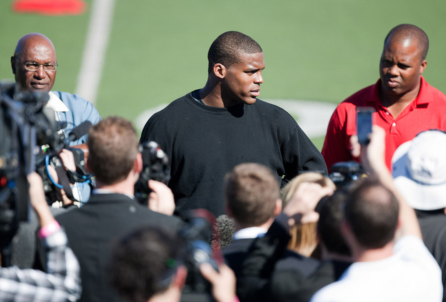 SAN DIEGO, CA - FEBRUARY 10: 2010 Heisman Trophy winning quarterback Cam Newton of Auburn answers questions after his workout routine for the media at Cathedral High School's sports stadium on February 10, 2011 in San Diego, California. (Photo by Kent Hor