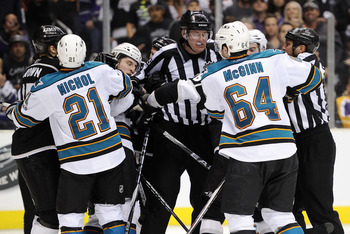 LOS ANGELES, CA - APRIL 25:  The referees break up a scuffle between the San Jose Sharks and the Los Angeles Kings in game six of the Western Conference Quarterfinals during the 2011 NHL Stanley Cup Playoffs at Staples Center on April 25, 2011 in Los Ange