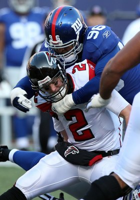 EAST RUTHERFORD, NJ - NOVEMBER 22:  Matt Ryan #2 of the Atlanta Falcons is sacked by Barry Cofield #96 of the New York Giants on November 22, 2009 at Giants Stadium in East Rutherford, New Jersey. The Giants defeated the Falcons 34-31 in overtime.  (Photo