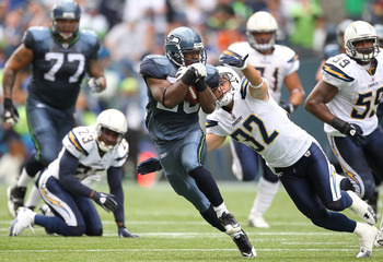 SEATTLE - SEPTEMBER 26:  Running back Justin Forsett #20 of the Seattle Seahawks rushes against Eric Weddle #32 of the San Diego Chargers at Qwest Field on September 26, 2010 in Seattle, Washington. The Seahawks defeated the Chargers 27-20. (Photo by Otto
