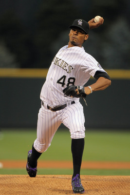 DENVER, CO - APRIL 18:  Starting pitcher Esmil Rogers #48 of the Colorado Rockies delivers against the San Francisco Giants at Coors Field on April 18, 2011 in Denver, Colorado. Rogers collected the loss as the Giants defeated the Rockies 8-1.  (Photo by