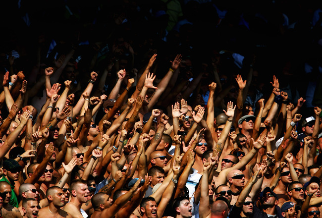 LONDON, ENGLAND - AUGUST 08:  Napoli fans sing and chant during the Bobby Moore Cup between West Ham United and Napoli at Upton Park on August 8, 2009 in London, England.  (Photo by Paul Gilham/Getty Images)