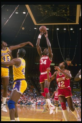 Center Hakeem Olajuwon of the Houston Rockets (center) goes up for two during a game against the Los Angeles Lakers at the Great Western Forum in Inglewood, California.
