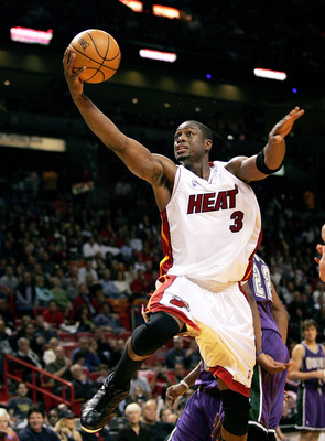MIAMI - DECEMBER 27:  Dwyane Wade #3 of the Miami Heat handles the ball for a lay up against the Milwaukee Bucks on December 27, 2005 at American Airlines Arena in Miami, Florida.  NOTE TO USER:  User expressly acknowledges and agrees that, by downloading