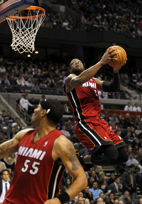 AUBURN HILLS, MI - MARCH 23: Dwyane Wade #3 of the Miami Heat gets in for a dunk while playing the Detroit Pistons at The Palace of Auburn Hills on March 23, 2011 in Auburn Hills, Michigan. NOTE TO USER: User expressly acknowledges and agrees that, by dow
