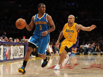 LOS ANGELES, CA - APRIL 20:  Chris Paul #3 of the New Orleans Hornets drives on Derek Fisher #2 of the Los Angeles Lakers in Game Two of the Western Conference Quarterfinals in the 2011 NBA Playoffs on April 20, 2011 at Staples Center in Los Angeles, Cali
