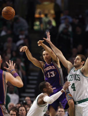BOSTON, MA - MARCH 02:  Steve Nash #13 of the Phoenix Suns passes the ball as Nenad Krstic #4 of the Boston Celtics and Rajon Rondo defend on March 2, 2011 at the TD Garden in Boston, Massachusetts.  NOTE TO USER: User expressly acknowledges and agrees th