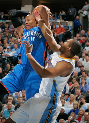 DENVER, CO - APRIL 23:  Russell Westbrook #0 of the Oklahoma City Thunder is fouled by Arron Afflalo #6 of the Denver Nuggets in Game Three of the Western Conference Quarterfinals in the 2011 NBA Playoffs at Pepsi Center on April 23, 2011 in Denver, Color