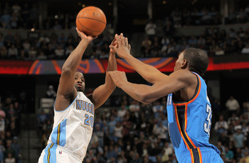 DENVER, CO - APRIL 25:  Raymond Felton #20 of the Denver Nuggets takes a shot over Kevin Durant #35 of the Oklahoma City Thunder in Game Four of the Western Conference Quarterfinals in the 2011 NBA Playoffs on April 24, 2011 at the Pepsi Center in Denver,