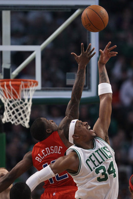 BOSTON, MA - MARCH 09:  Paul Pierce #34 of the Boston Celtics and Eric Bledsoe #12 of the Los Angeles Clippers jump for the ball on March 9, 2011 at the TD Garden in Boston, Massachusetts. The Los Angeles Clippers defeated the Boston Celtics 108-103. NOTE