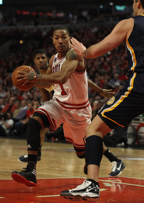 CHICAGO, IL - APRIL 18: Derrick Rose #1 of the Chicago Bulls moves against Jeff Foster #10 of the Indiana Pacers in Game Two of the Eastern Conference Quarterfinals in the 2011 NBA Playoffs at the United Center on April 18, 2011 in Chicago, Illinois. The