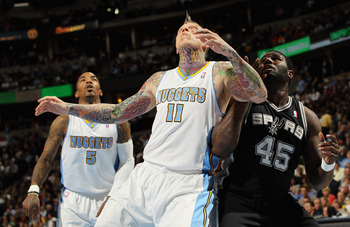 DENVER, CO - MARCH 23:  Chris Andersen #11 of the Denver Nuggets battle for position with DeJuan Blair #45 of the San Antonio Spurs at the Pepsi Center on March 23, 2011 in Denver, Colorado. The Nuggets defeated the Spurs 115-112. NOTE TO USER: User expre
