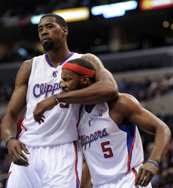 LOS ANGELES, CA - DECEMBER 01:  Baron Davis #5 and DeAndre Jordan #9 of the Los Angeles Clippers reacts after a defensive stop against the San Antonio Spurs during a 90-85 Clipper win at the Staples Center on December 1, 2010 in Los Angeles, California.