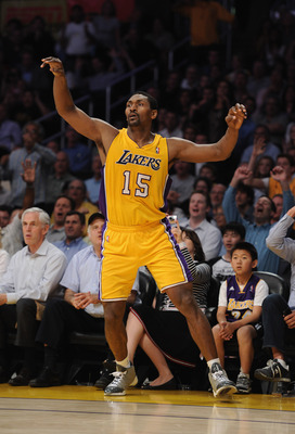 LOS ANGELES, CA - MARCH 31:  Ron Artests #15 of the Los Angeles Lakers watches his three point attempt at Staples Center on March 31, 2011 in Los Angeles, California.  NOTE TO USER: User expressly acknowledges and agrees that, by downloading and or using