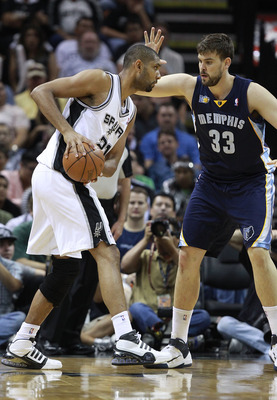 SAN ANTONIO, TX - APRIL 27: Marc Gasol #33 of the Memphis Grizzlies defends against Tim Duncan #21 of the San Antionio Spurs in Game Five of the Western Conference Quarterfinals in the 2011 NBA Playoffs on April 27, 2011 at AT&T Center in San Antonio, Tex
