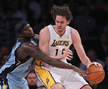 LOS ANGELES, CA - JANUARY 02:  Zach Randolph #50 of the Memphis Grizzlies attempts to steal the ball away from Pau Gasol #16 of the Los Angeles Lakers during the first half at Staples Center on January 2, 2011 in Los Angeles, California. The Grizzlies def
