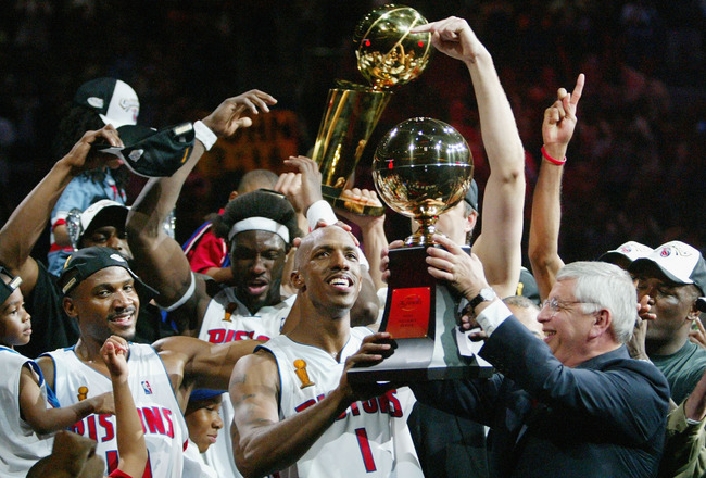 AUBURN HILLS, MI - JUNE 15:  Chauncey Billups #1 (C) of the Detroit Pistons receives the Finals MVP trophy from NBA commissioner David Stern (R) after defeating the Los Angeles Lakers 100-87 in game five of the 2004 NBA Finals on June 15, 2004 at The Pala