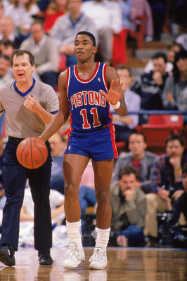 1989:  Isiah Thomas #11 of the Detroit Pistons advances the ball during a game in the 1988-1989 NBA season.   (Photo by Tim Defrisco/Getty Images)