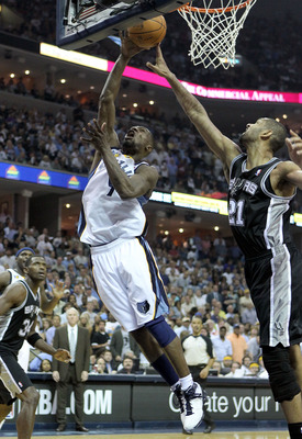 MEMPHIS, TN - APRIL 29:  Tony Allen #9 of the Memphis Grizzlies shoots the ball while defended by Tim Duncan #21 of the San Antonio Spurs during the Grizzlies 99-91 win over the Spurs  in Game Six of the Western Conference Quarterfinals in the 2011 NBA Pl