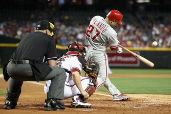 PHOENIX, AZ - APRIL 25:  Placido Polanco #27 of the Philadelphia Phillies hits a single against the Arizona Diamondbacks during the Major League Baseball game at Chase Field on April 25, 2011 in Phoenix, Arizona.  The Diamondbacks defeated the Phillies 4-