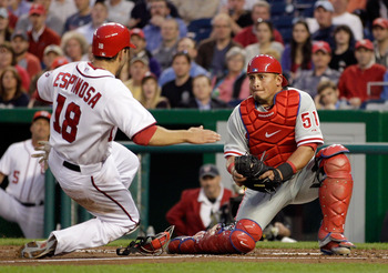 WASHINGTON, DC - APRIL 14:  Catcher Carlos Ruiz #51 of the Philadelphia Phillies tags out Danny Espinosa #18 of the Washington Nationals trying to score at home plate during the third inning at Nationals Park on April 14, 2011 in Washington, DC.  (Photo b
