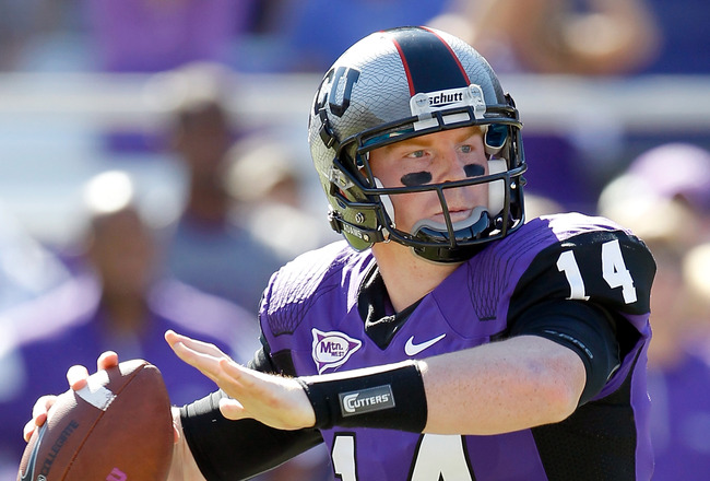 FORT WORTH, TX - OCTOBER 16:  Quarterback Andy Dalton #14 of the TCU Horned Frogs looks for a receiver against the BYU Cougars at Amon G. Carter Stadium on October 16, 2010 in Fort Worth, Texas.  (Photo by Tom Pennington/Getty Images)