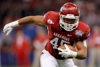 NEW ORLEANS, LA - JANUARY 04:  D.J. Williams #45 of the Arkansas Razorbacks runs after a catch in the first half against the Ohio State Buckeyes during the Allstate Sugar Bowl at the Louisiana Superdome on January 4, 2011 in New Orleans, Louisiana.  (Phot