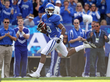 LEXINGTON, KY - NOVEMBER 13: Chris Matthews #8 of the Kentucky Wildcats runs for a touchdown after a reception during the game against the Vanderbilt Commodores at Commonwealth Stadium on November 13, 2010 in Lexington, Kentucky.  (Photo by Andy Lyons/Get