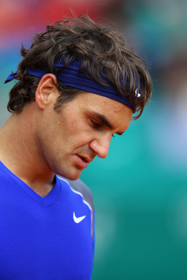 MONACO - APRIL 15:  Roger Federer of Switzerland looks down in his match against Jurgen Melzer of Austria during Day Six of the ATP Masters Series Tennis at the Monte Carlo Country Club on April 15, 2011 in Monte Carlo, Monaco.  (Photo by Julian Finney/Ge