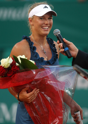 MONACO - APRIL 11:  Caroline Wozniacki of Denmark smiles after her match against Francesca Schiavone of Italy in the womens exhibition match during Day Two of the ATP Masters Series Tennis at the Monte Carlo Country Club on April 11, 2011 in Monte Carlo,