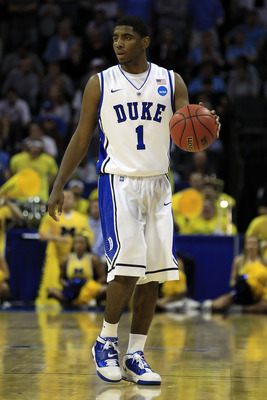 CHARLOTTE, NC - MARCH 20:  Kyrie Irving #1 of the Duke Blue Devils moves the ball while taking on the Michigan Wolverines during the third round of the 2011 NCAA men's basketball tournament at Time Warner Cable Arena on March 20, 2011 in Charlotte, North