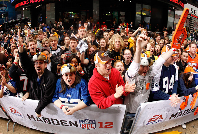 NEW YORK - APRIL 28:  Fans cheer during the EA Sports Madden NFL 12 cover photo shoot on April 28, 2011 in Time Square, New York City  (Photo by Mike Stobe/Getty Images for EA Sports)