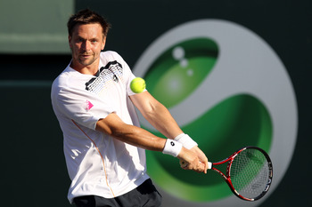 KEY BISCAYNE, FL - MARCH 27:  Robin Soderling of Sweden hits a backhand return against Juan Martin Del Potro of Argentina during the Sony Ericsson Open at Crandon Park Tennis Center on March 27, 2011 in Key Biscayne, Florida.  (Photo by Al Bello/Getty Ima