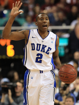 GREENSBORO, NC - MARCH 12:  Nolan Smith #2 of the Duke Blue Devils calls a play as he brings the ball up the court against the Virginia Tech Hokies during the first half in the semifinals of the 2011 ACC men's basketball tournament at the Greensboro Colis