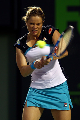 KEY BISCAYNE, FL - MARCH 30:  Kim Clijsters of Belgium hits a backhand return against Victoria Azarenka of Belarus during the Sony Ericsson Open at Crandon Park Tennis Center on March 30, 2011 in Key Biscayne, Florida.  (Photo by Clive Brunskill/Getty Ima