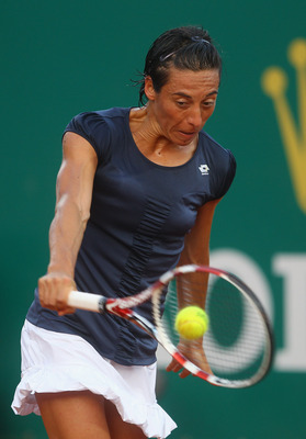 MONACO - APRIL 11:  Francesca Schiavone of Italy in action against Caroline Wozniacki of Denmark in the womens exhibition match during Day Two of the ATP Masters Series Tennis at the Monte Carlo Country Club on April 11, 2011 in Monte Carlo, Monaco.  (Pho