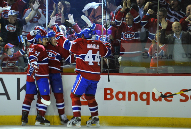 MONTREAL, CANADA - APRIL 18:  Tomas Plekanec #14; Andrei Kostitsyn #46 and Roman Hamrlik #44 of the Montreal Canadiens celebrate a goal against the Boston Bruins in Game Three of the Eastern Conference Quarterfinals during the 2011 NHL Stanley Cup Playoff
