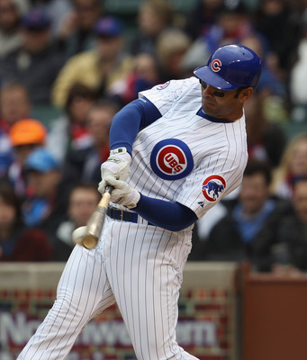 CHICAGO, IL - APRIL 20: Carlos Pena #22 of the Chicago Cubs hits the ball against the San Diego Padres at Wrigley Field on April 20, 2011 in Chicago, Illinois. The Cubs defeated the Padres 2-1 in 11 innings. (Photo by Jonathan Daniel/Getty Images)