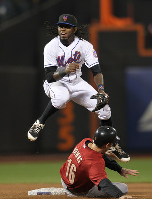 NEW YORK, NY - APRIL 21: Jose Reyes #7 of the New York Mets turns a double play over the slide of Matt Downs #16 of the Houston Astros at Citi Field on April 21, 2011 in the Flushing neighborhood of the Queens borough of New York City.  (Photo by Nick Lah
